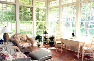 Sun porch with flowery and white furniture