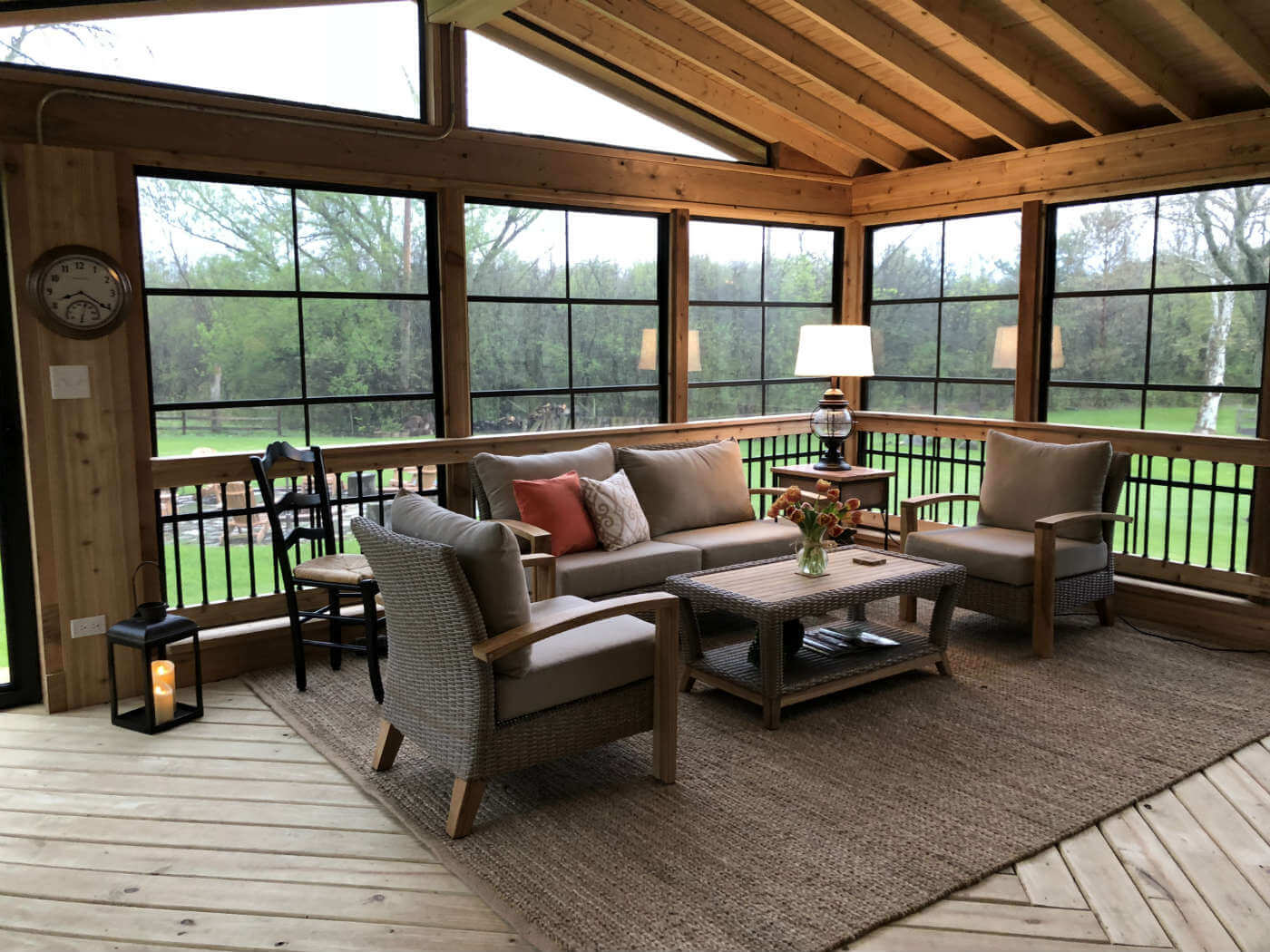 Custom screened porch with 4 track vertical windows