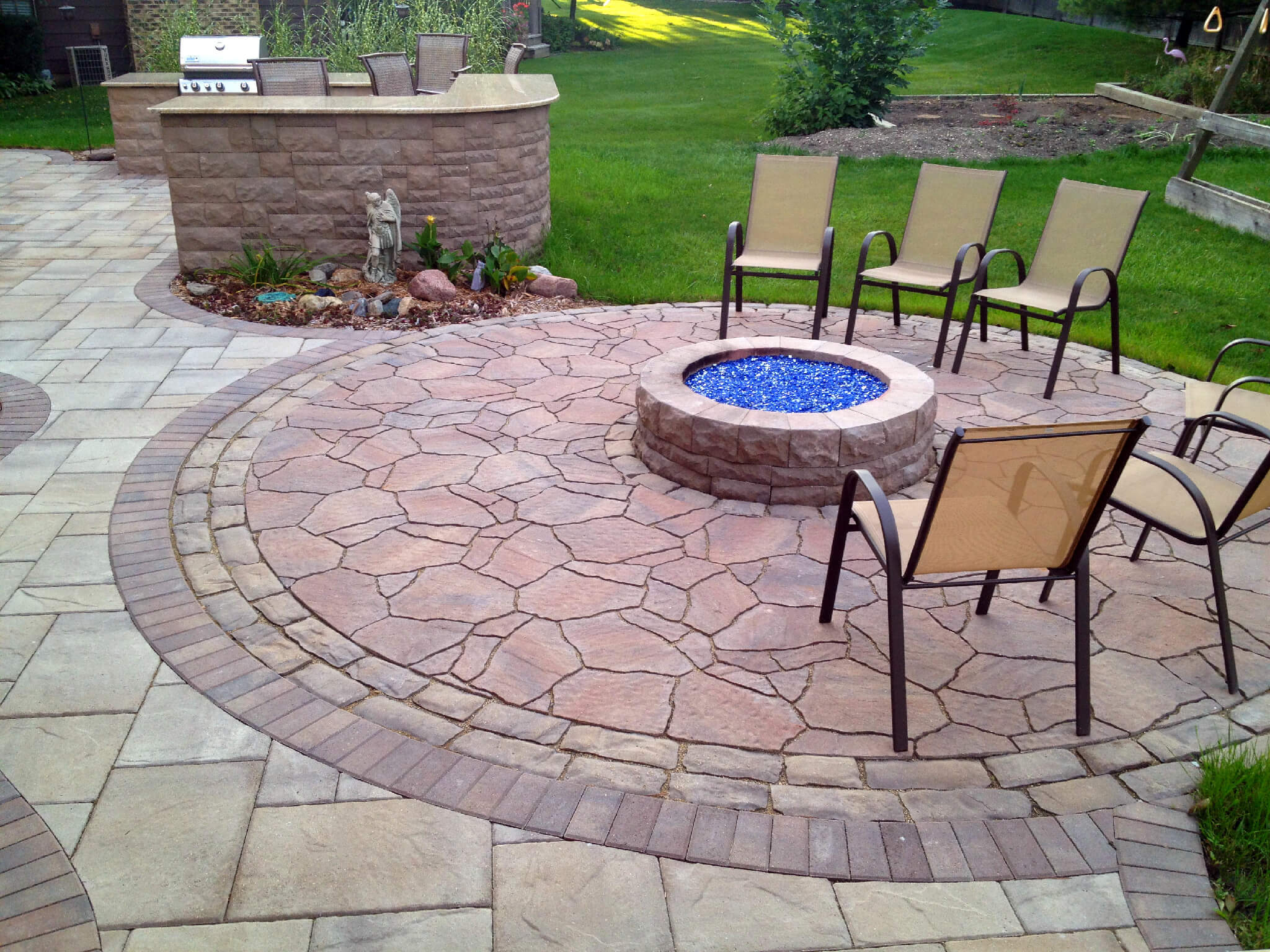 Custom patio with outdoor kitchen and fire pit