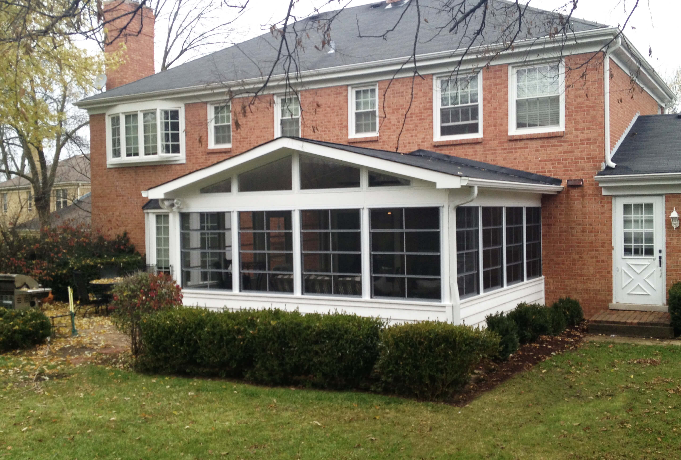 Custom screened porch with sunroom