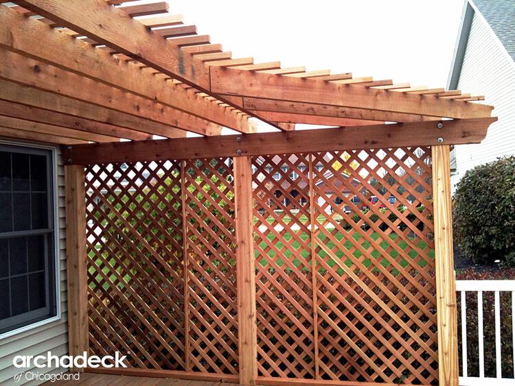 Cedar pergola with lattice privacy wall