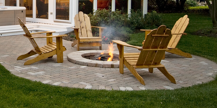 Custom fire pit with wooden chair