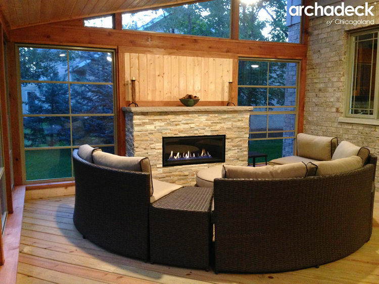 Custom outdoor fire place with screen porch