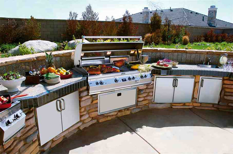 Custom outdoor kitchen with grilling steaks