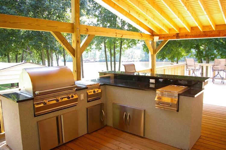 Custom outdoor kitchen under covered porch