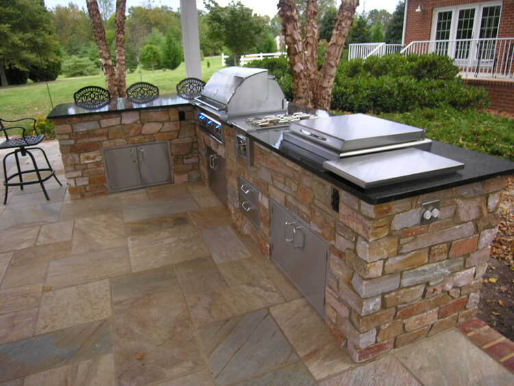 Custom outdoor kitchen with dining bar