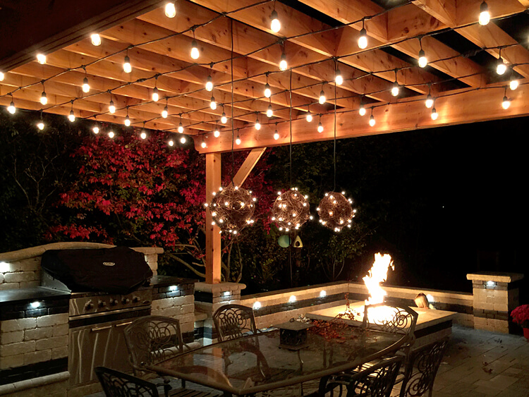 Custom outdoor kitchen with fire pit