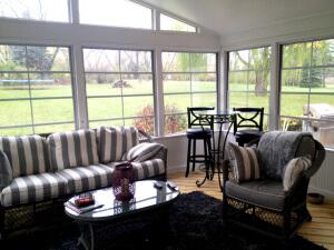 Custom screened porch with 4 track windows