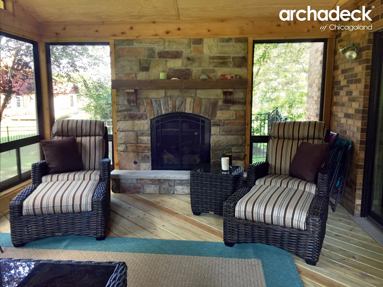 Custom screen porch with stone fireplace