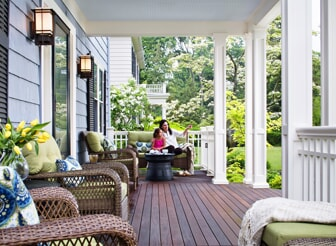 front porch with mother and daughter sitting on bench