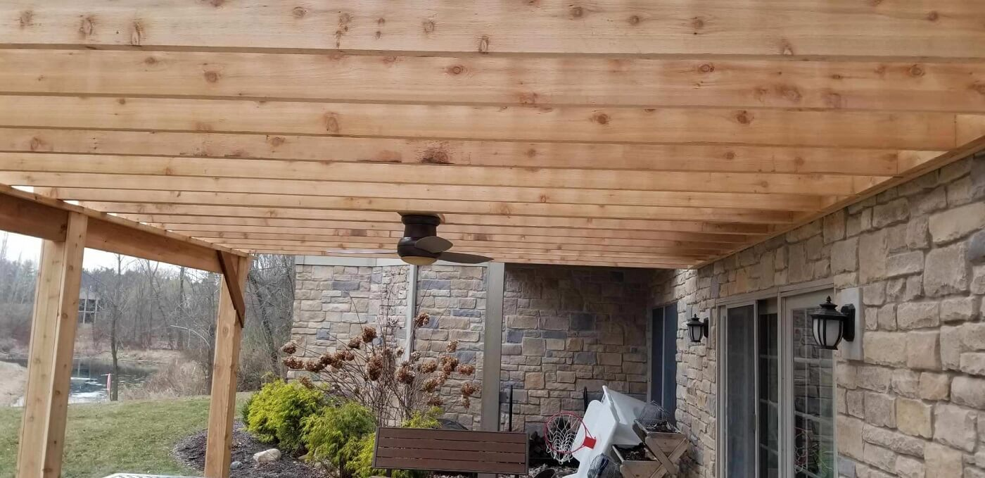 Custom wood pergola with ceiling fan