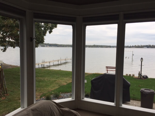 Lake view from inside of screened porch