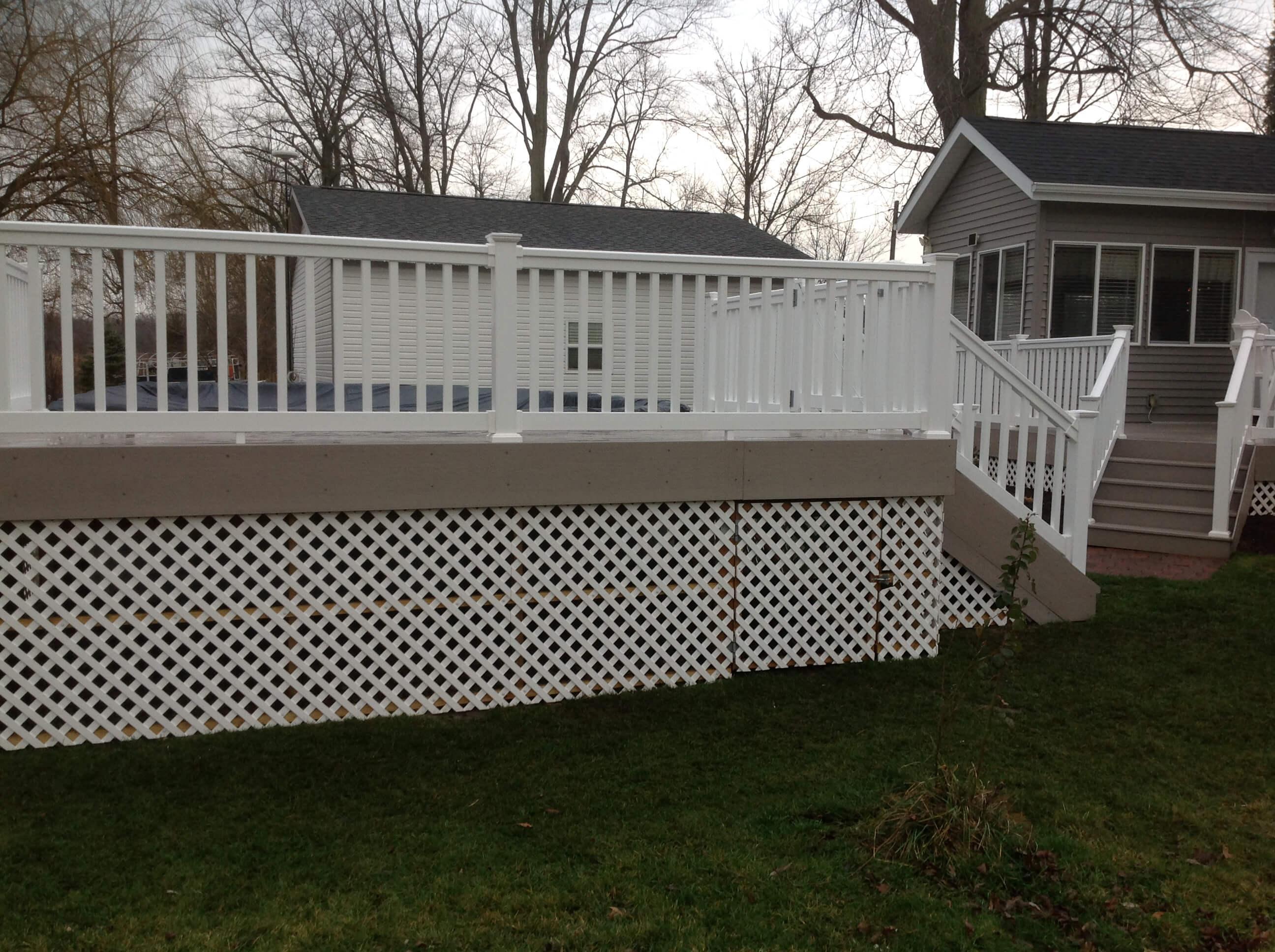 Custom backyard deck with white railing