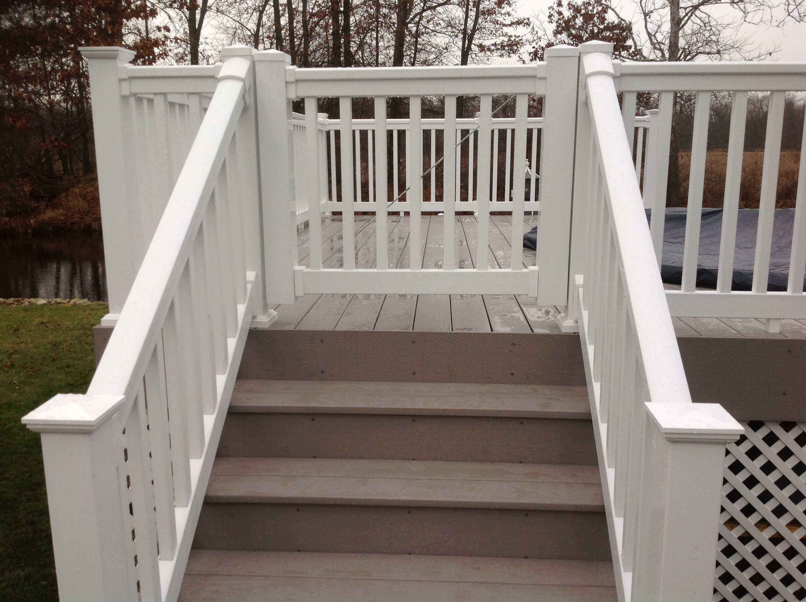Deck staircase with gate