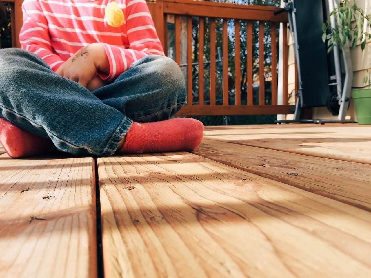 Kid sitting on deck floor