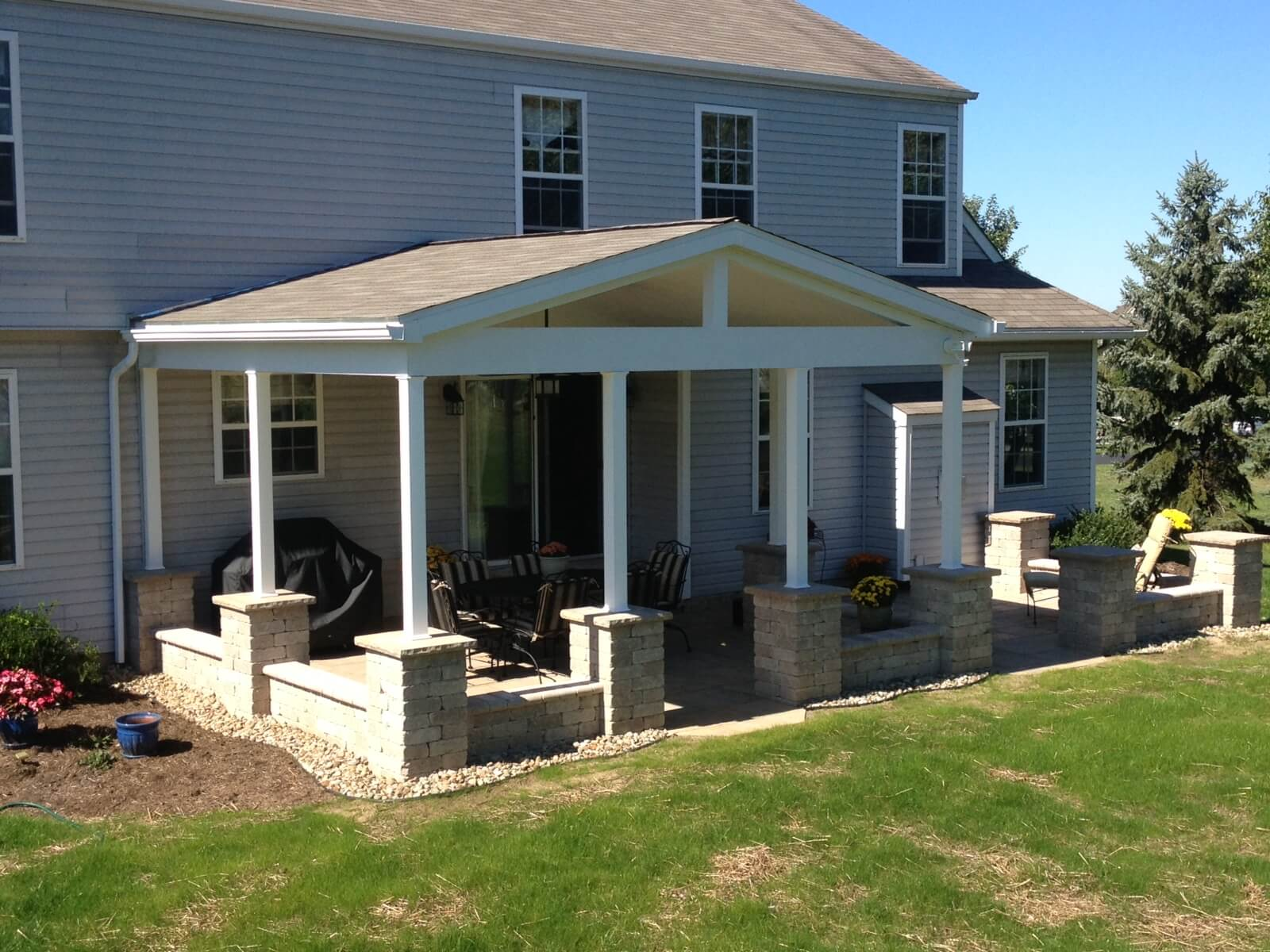 Custom open porch with stone columns