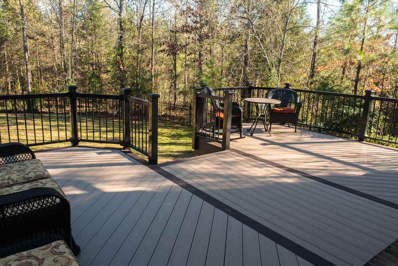 Custom backyard deck with railing