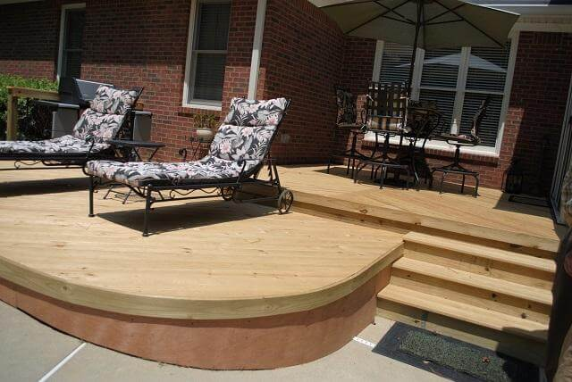 Custom low maintenance deck with lounge chairs