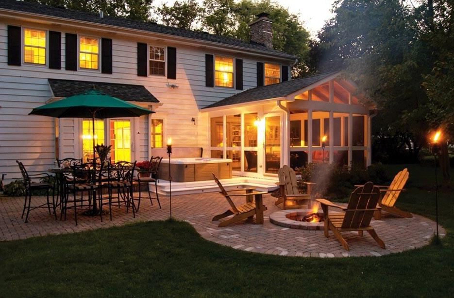 Custom screened porch and patio with hot tub and fire pit