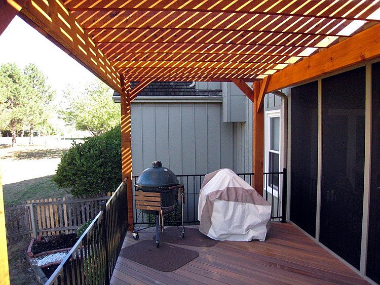 Outdoor kitchen and pergola on deck