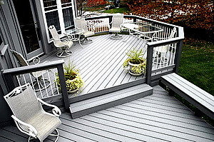 Custom multi-level deck with railing and floating bench