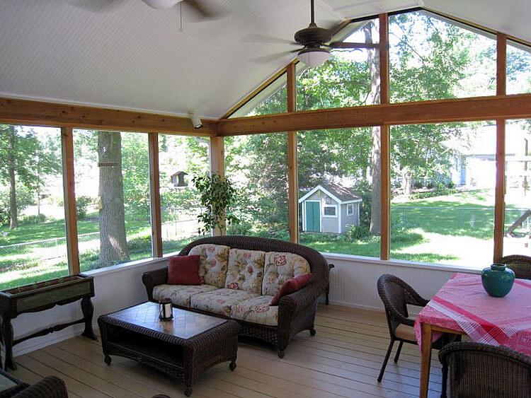 Cozy custom screened porch with backyard view
