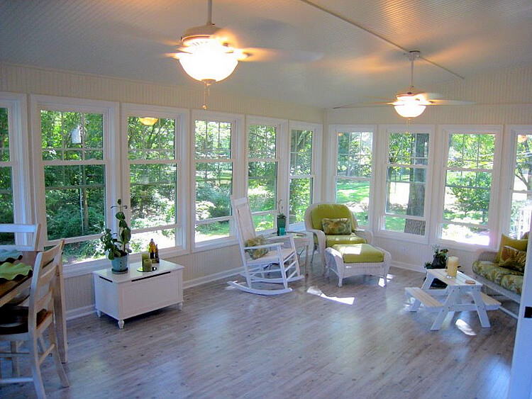 Cozy custom sunroom with backyard view