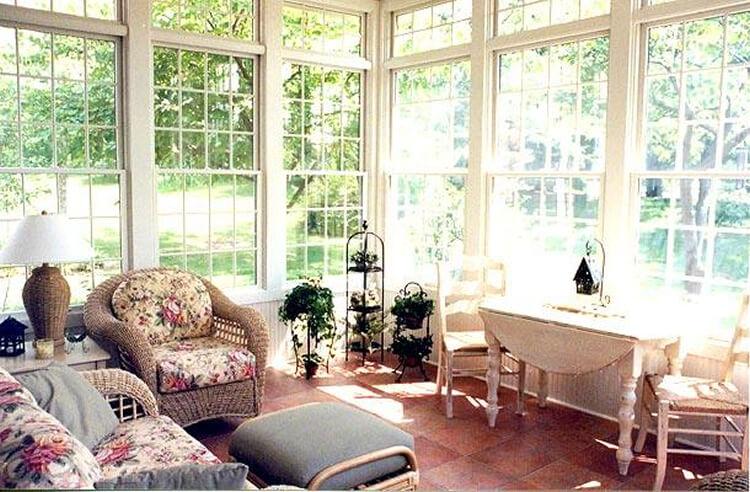 Cozy custom two season room with backyard view