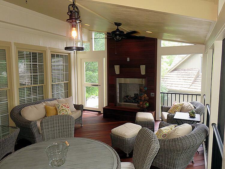 Cozy interior of custom sunroom with outdoor fireplace