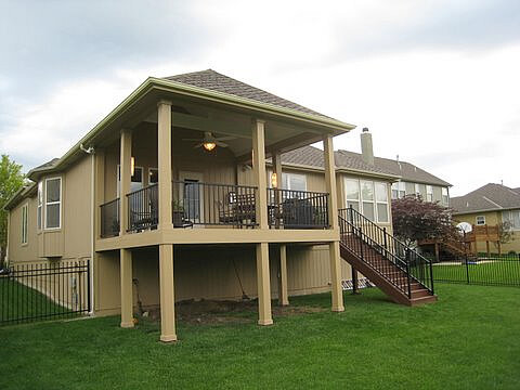 Custom backyard open porch and grill deck