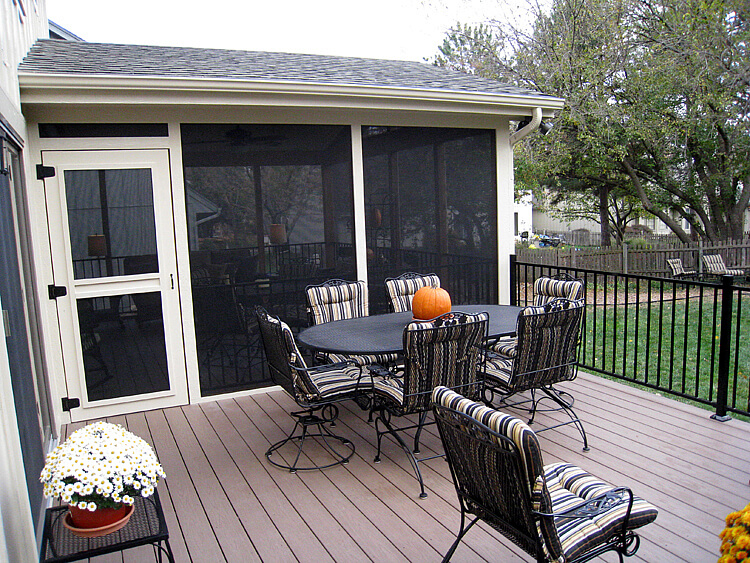 Custom backyard screened porch and deck with dining table