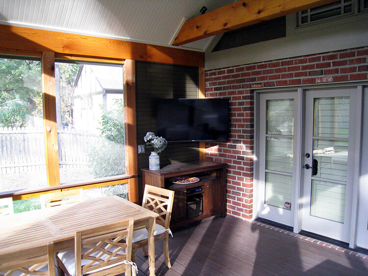 Corner TV wall on screened porch