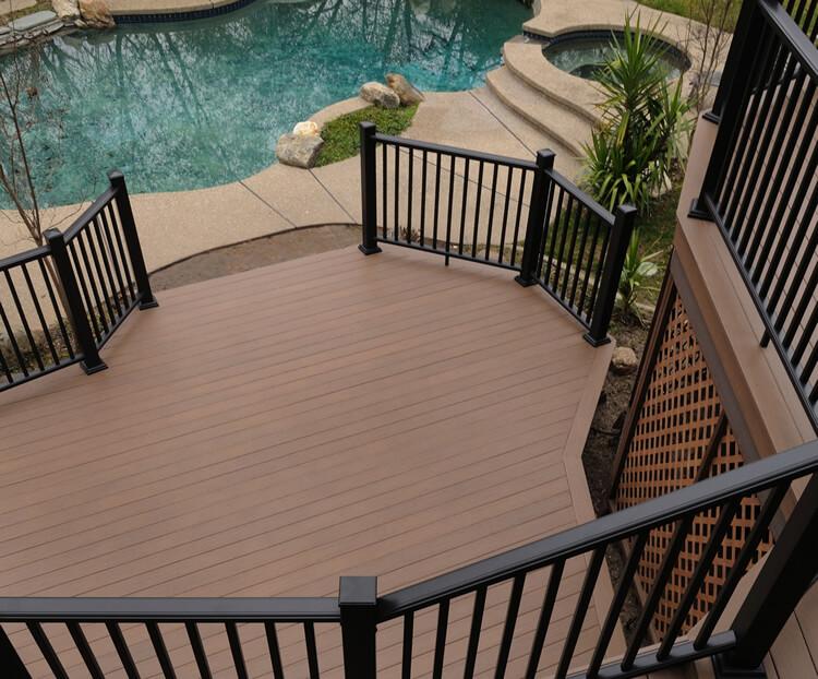 Custom multi-level poolside deck with railing