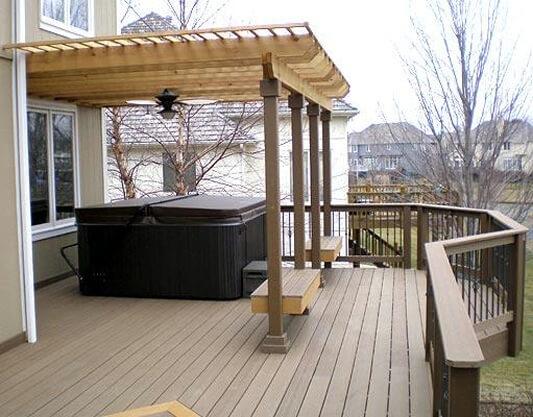 Custom deck with pergola over hot tub