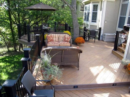 Cozy seating area on custom backyard deck