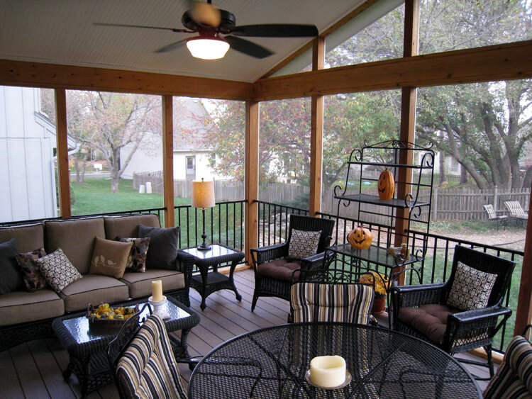 Cozy seating area on custom screened porch