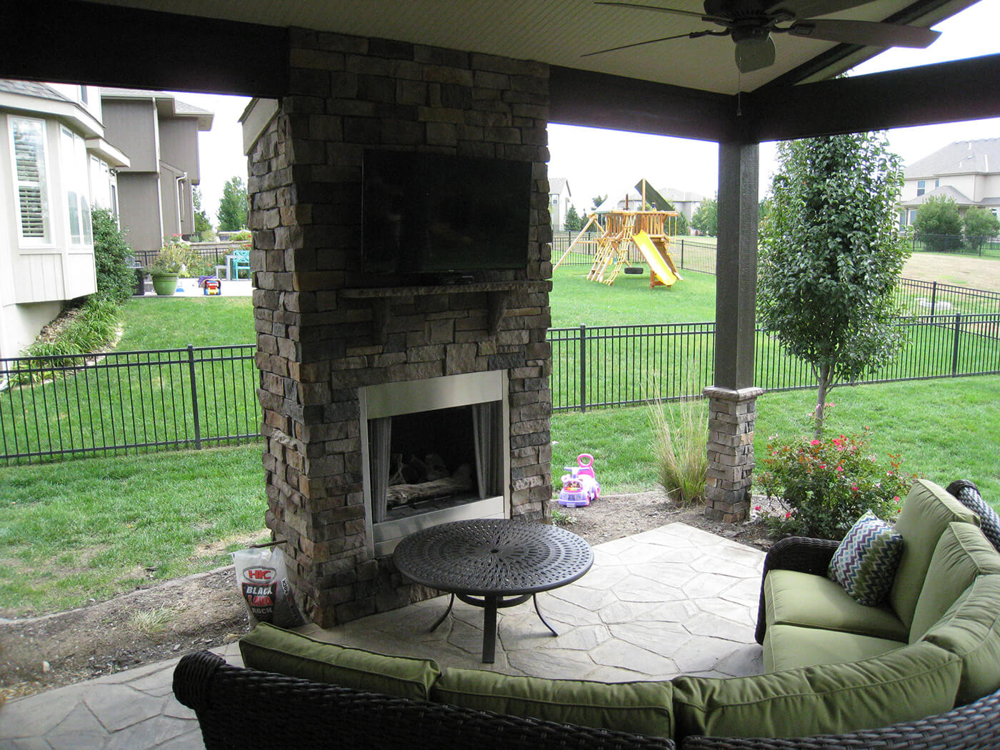Custom outdoor fireplace on open porch