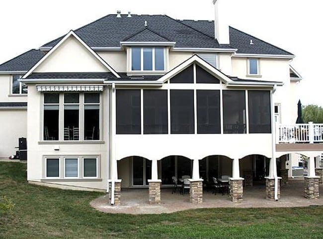 Custom screened porch and deck with stone columns