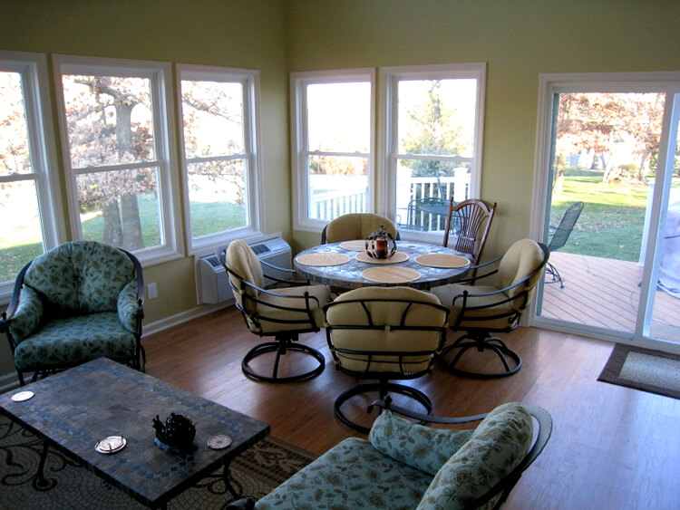Dining area on sunroom with backyard view