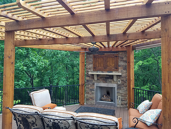 deck with outdoor fireplace