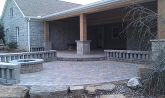 rustic stone porch with fire feature