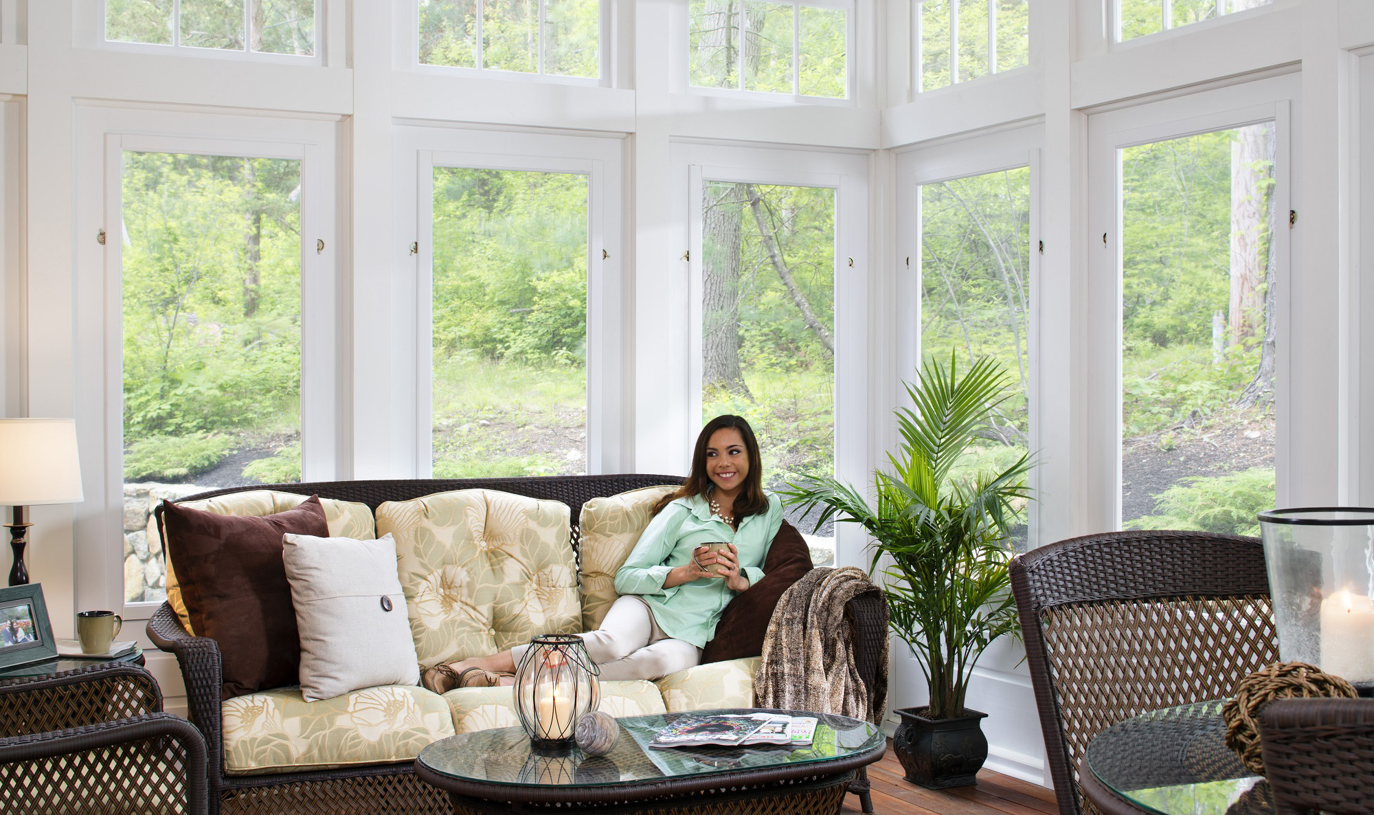 White sunroom with person sitting on the couch