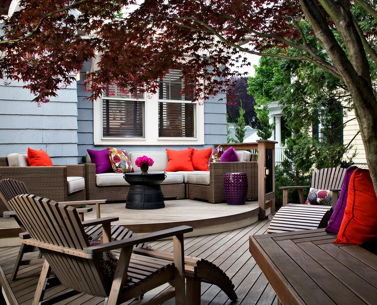 open wood deck with chairs and trees