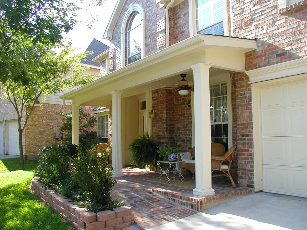 This front porch design features square columns and a shed roof