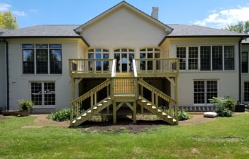 elevated wooden deck with iron pickets