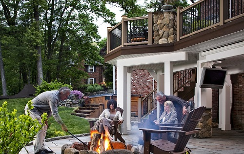 people enjoying new fire feature on patio