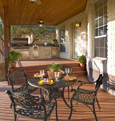 Outdoor kitchen and seating area on a deck
