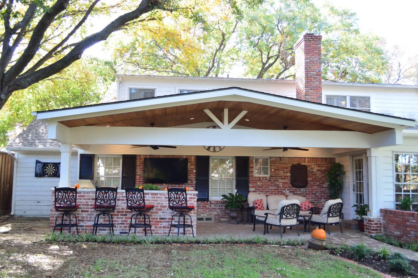 Covered Patio Addition With Brick Bar