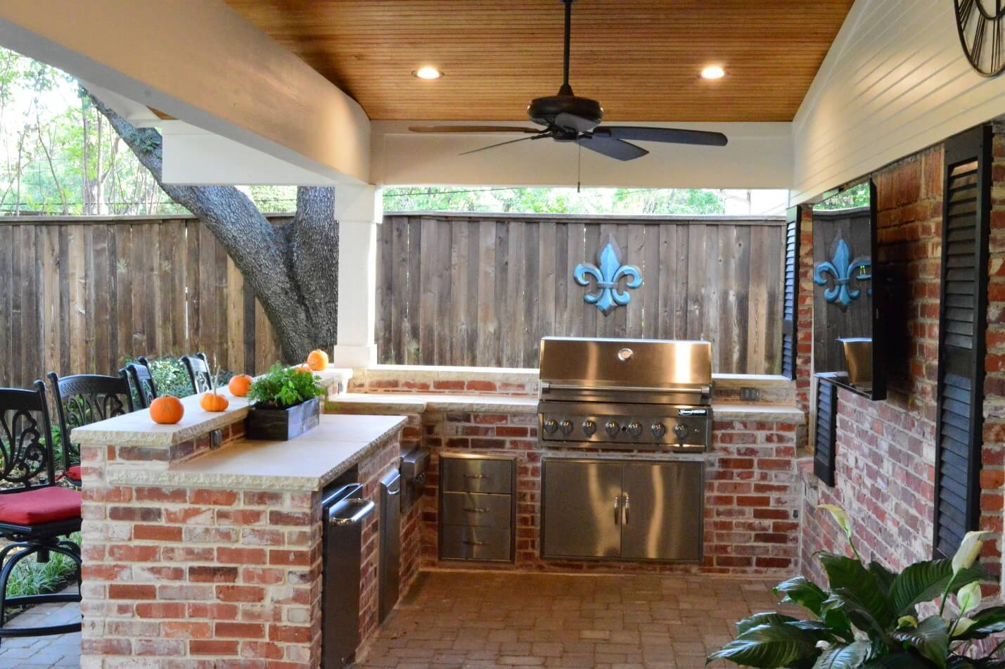 Covered Outdoor Living Space With Grill