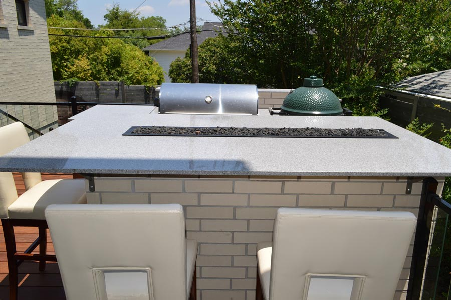 Outdoor kitchen with custom fire table